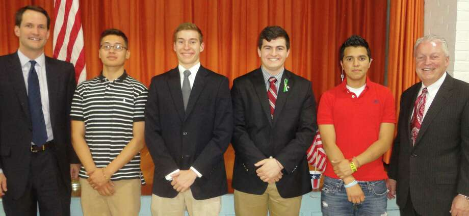 U.S. Rep. James Himes, left, and Fairfield First Selectman Michael Tetreau, right, flank four local high school seniors, all of whom have enlisted in the military service. Honored Tuesday at a program sponsored by the Greater Fairfield Board of Realtors they are, from left, Julio Galindo Jr., 18, Fairfield Warde High School; Christopher Bayer, 17, Fairfield College Preparatory School; Matthew J. Rahtelli, 18, Fairfield College Preparatory School, and Jayson Amoroso, 18, Fairfield Ludlowe High School.   FAIRFIELD CITIZEN, CT 5/28/13 Photo: Meg Barone / Fairfield Citizen freelance