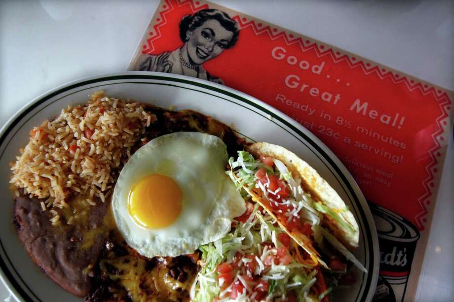 The Roosevelt Special at El Real Tex-Mex includes two cheese enchiladas with a fried egg, refried bean chalupa and a crispy beef taco. Photo: Johnny Hanson, Staff / © 2011 Houston Chronicle