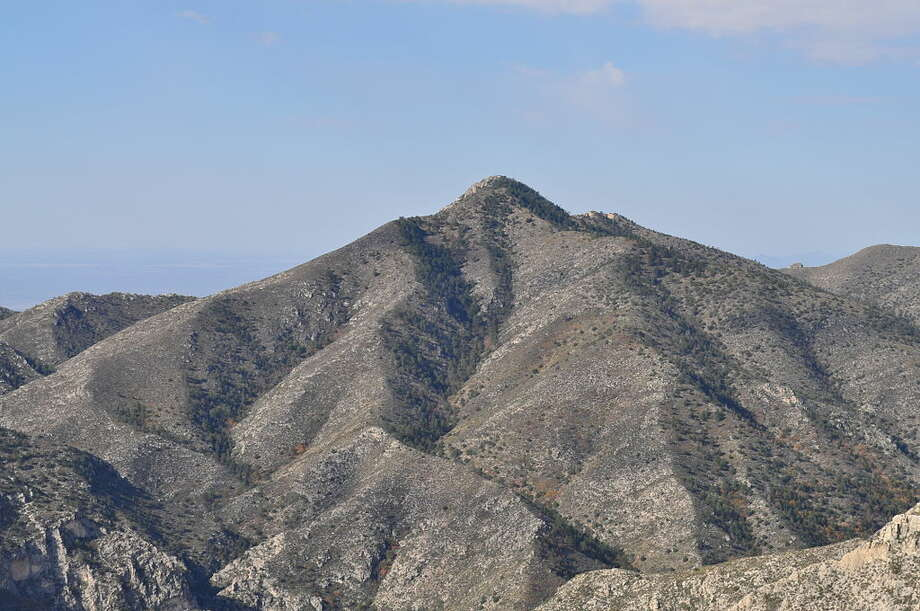 """Shumard Peak: 8,615 feet Reaching this summit in Guadalupe Mountains National Park, according to summitpost.org, """"involves thrashing through prickly desert brush on rocky, trail-less terrain. Indeed, many may argue this is the hardest-won of the primary, named summits in the main section of the park."""" Photo: Fredlyfish4 / Wikimedia Commons"""