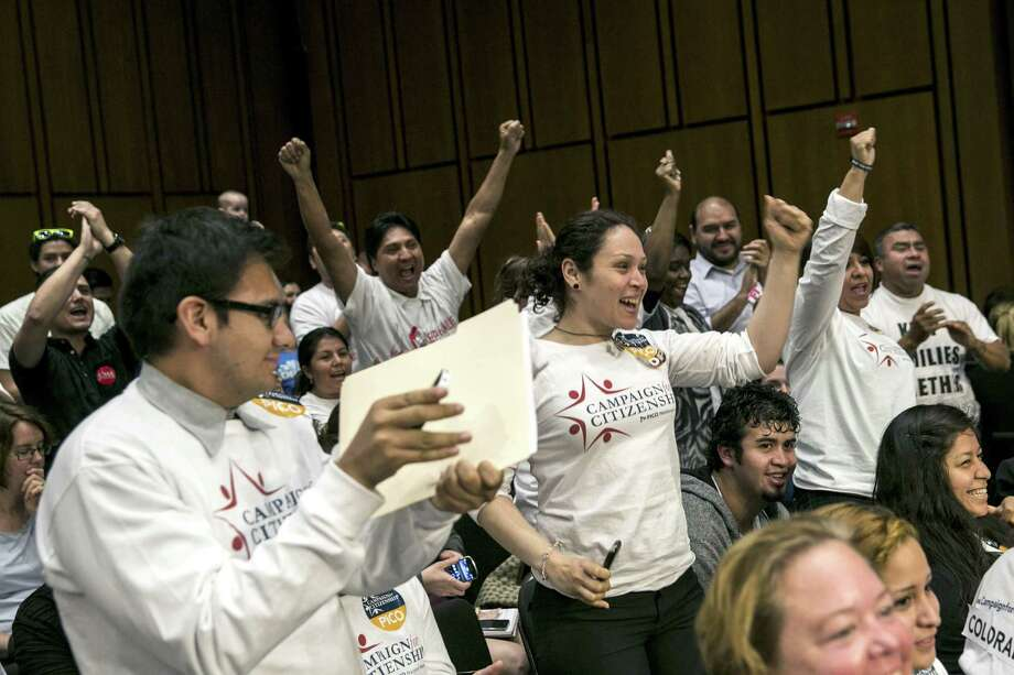 Supporters of immigration reform cheer on Capitol Hill after the Senate Judiciary Committee approved legislation to overhaul the nation's immigration laws this month. The recent digital march on Washington stressed the role of immigrants in the U.S. economy. Photo: Drew Angerer / New York Times