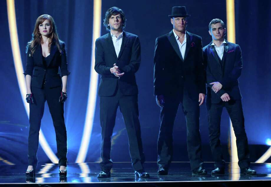 "Isla Fisher, Jesse Eisenberg, Woody Harrelson and Dave Franco in the movie ""Now You See Me."" AP photo Photo: Barry Wetcher, Associated Press / Summit Entertainment"