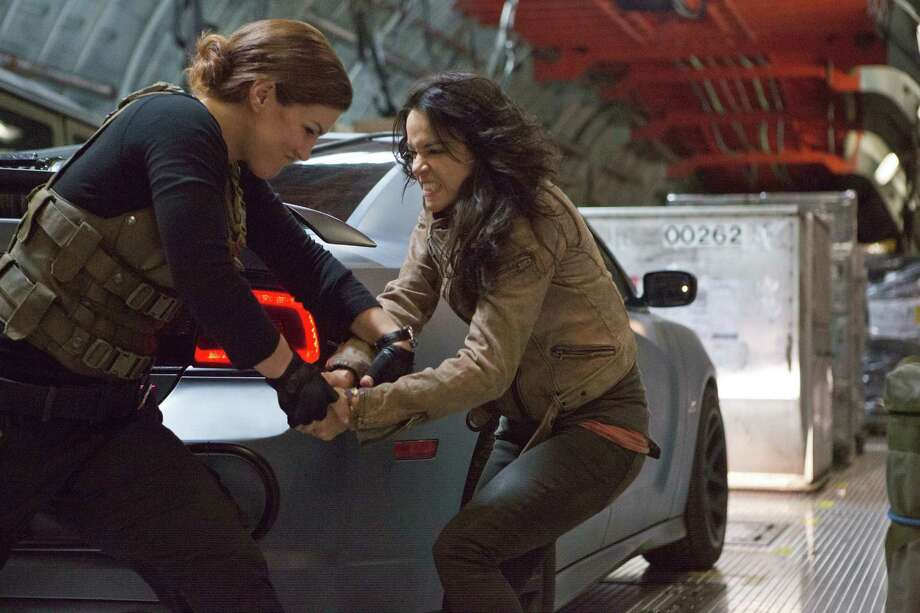 "Riley (Gina Carano) and Letty (Michelle Rodriguez) are more than pretty faces in ""Fast & Furious 6."" Photo: Universal Pictures"