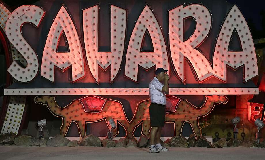 Vintage signs await tourists at Las Vegas' Neon Museum, which recently began evening hours. Photo: Julie Jacobson, Associated Press