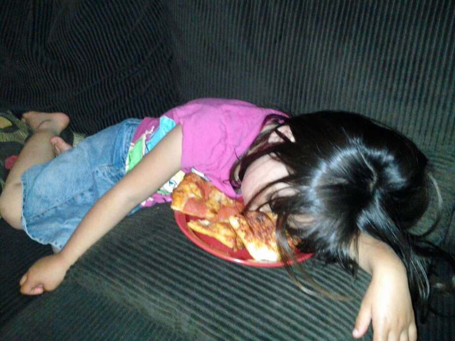 Passed out over a plate of pizza. Photo: Steve Connacher