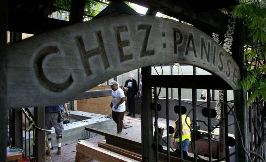 Workers bolt a three ton A-frame to the foundation as it is put into place on the front porch of Chez Panisse in Berkeley, Calif. on Tues. April 30, 2013. Photo: Michael Macor/The Chronicle