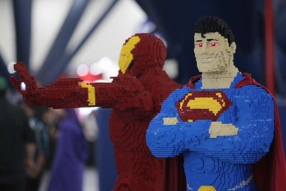 A Lego Iron Man and Superman on display