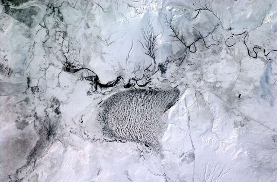 """Not sure, but I think that's a field of sand dunes covered in snow."" -- Col. Chris Hadfield"