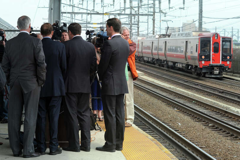An M8 Metro North train pull thru Bridgeport, Conn. station during a press confernce with, from left