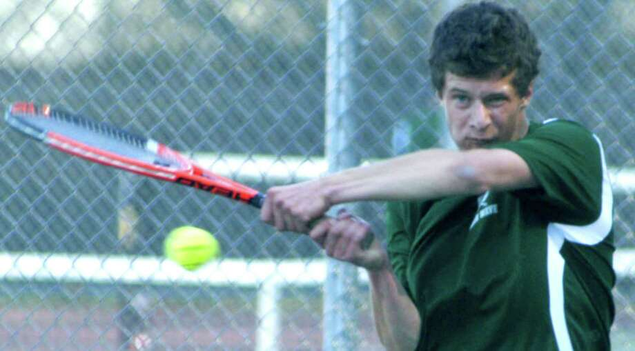The Green Wave's Dan Winters unleashes a backhand while competing during the regular season for New Milford High School boys' tennis, May 2013. Photo: Norm Cummings