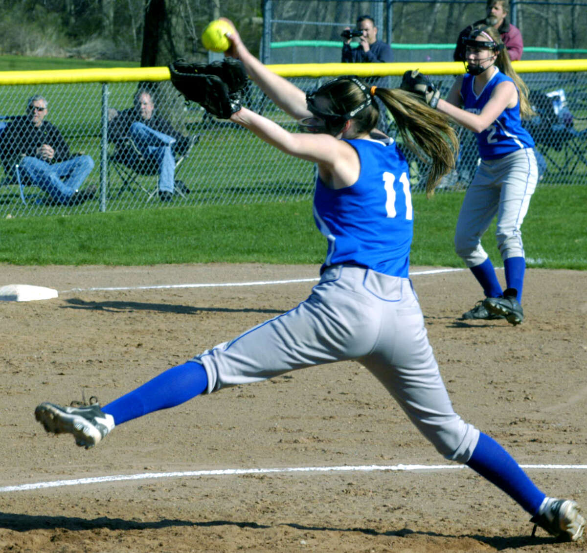 The Spartans' Kelsey Johnson winds for a pitch to home plate as teammate Allison Drzal plays 'D' at third base for Shepaug Valley High School softball, May 2013