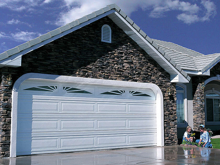 Reinforce your garage door: You can prevent severe damage in your home by reinforcing your garage door. This can prevent wind from getting into your home. Photo:  carywaynepeterson, FlickrSource: FEMA Photo: Flickr