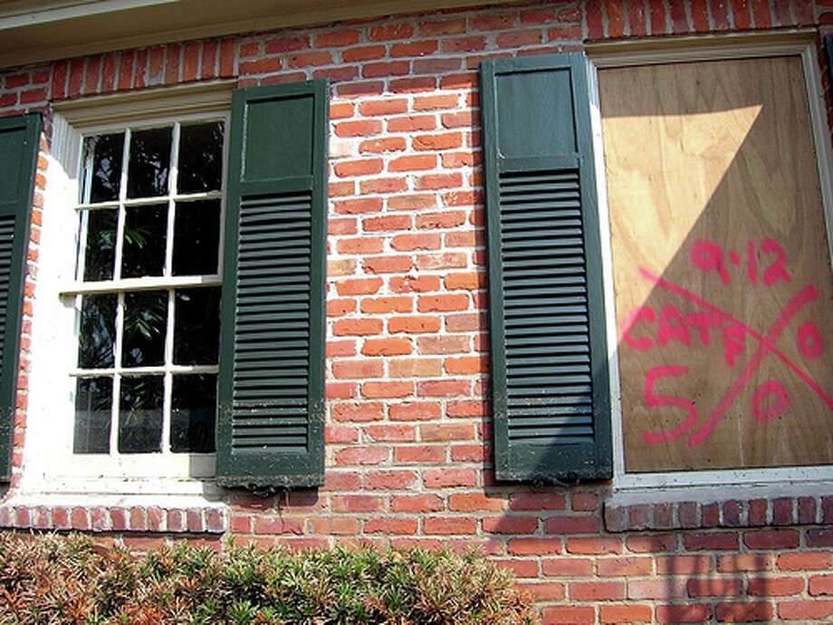 "Board windows: Permanent storm shutters offer the best protection for windows. A second option is to board up windows with 5/8"" marine plywood, cut to fit and ready to install. Tape does not prevent windows from breaking.Photo: melinnis, FlickrSource: FEMA Photo: Flickr"
