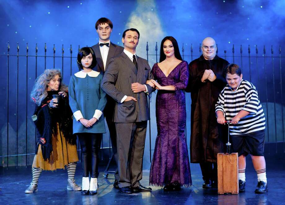 """""""The Addams Family"""" will premiere in Orange June 19-20. The recast show will include prior tour performers Jennifer Fogerty as Wednesday (second from left) and Dan Olson as Lurch (standing behind family). Photo: 'The Addams Family' / Connecticut Post Contributed"""