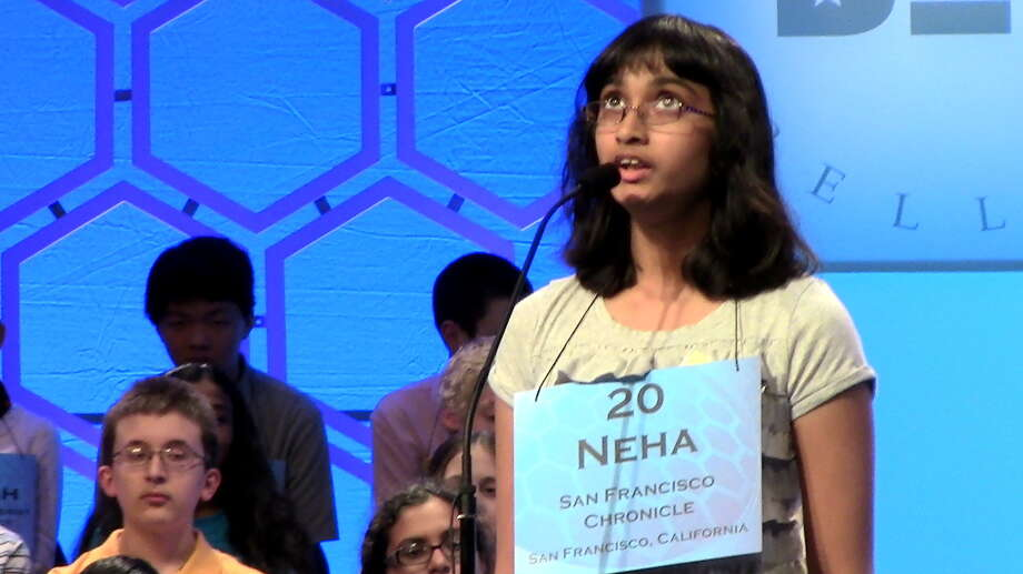 """Neha Konakallo, the 13-year-old speller from Cupertino, Calif., scored again Wednesday afternoon in the second round of oral spelling competition in the 86 annual Scripps National Spelling Bee by correctly spelling """"eccrinology,'' a branch of physiology. Photo: Nicole Narea"""