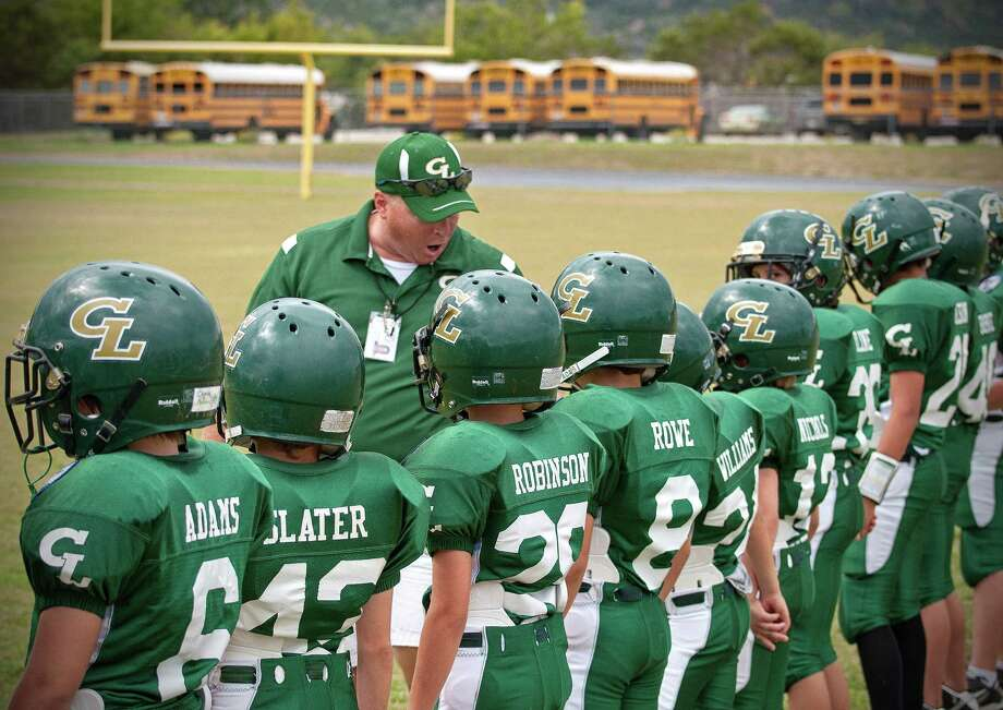 Canyon Lake Hawks Youth Football coach Charles Slater gives a pep talk before a game. Slater was recently diagnosed with osteosarcoma, at type of bone cancer. Courtesy photo