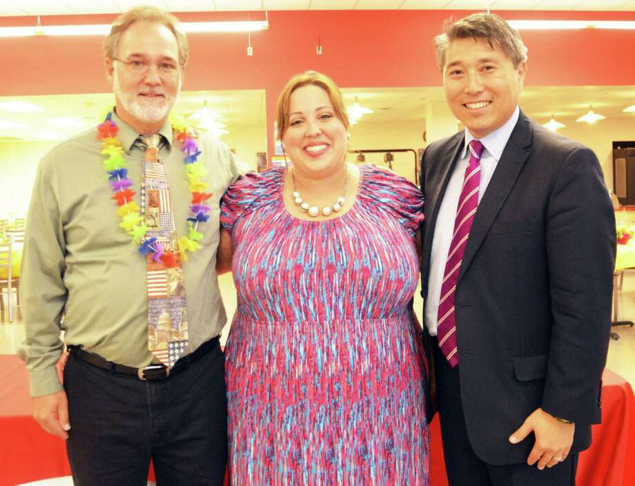 Terry Lee Mullen, left, and Jennifer West were congratulated by Comal ISD Superintendent Andrew Kim. Photo: Courtesy Photo