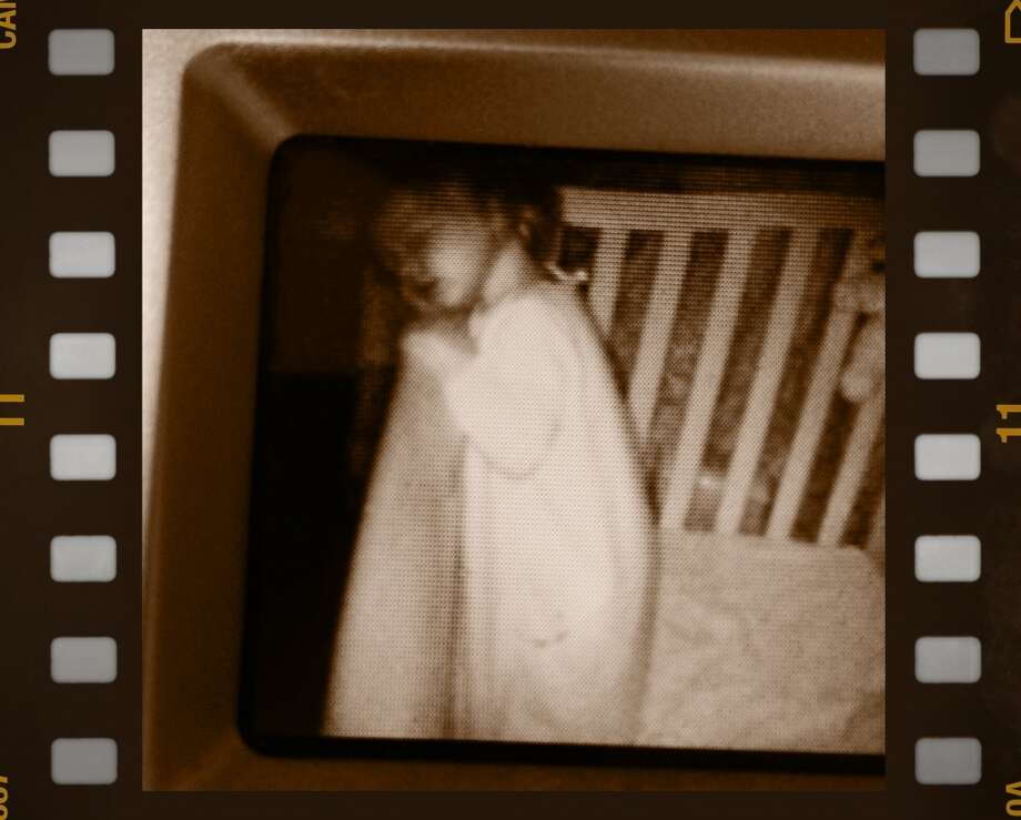 Emma fell asleep standing up in her crib! Photo: Andrew Johnson