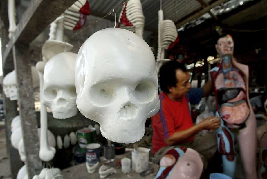 Darn, I'm fresh out of Small Intestine Pink:Hamim applies a final coat to a   human anatomy model that he made at his workshop on the outskirts of Jakarta.   A full-body model sells for 600,000 rupiah ($62). Photo: Tatan Syuflana, Associated Press