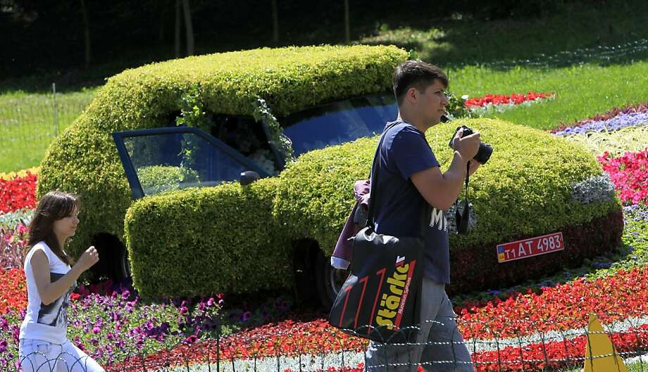 Baby, you can drive my shrub:Priuses, Leafs and Volts get all the publicity, but the greenest cars are in Kiev. Photo: Sergei Chuzavkov, Associated Press