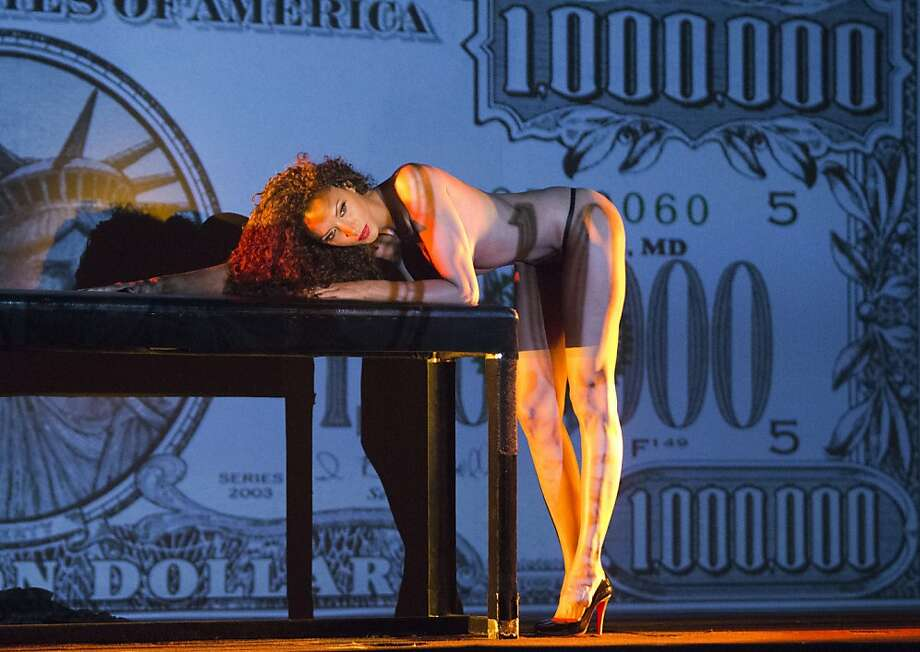 "Looking like a million bucks,French lingerie model Noemie Lenoir performs a scene from the new revue ""Freedom"" at the Crazy Horse Cabaret in Paris. Photo: Jacques Brinon, Associated Press"
