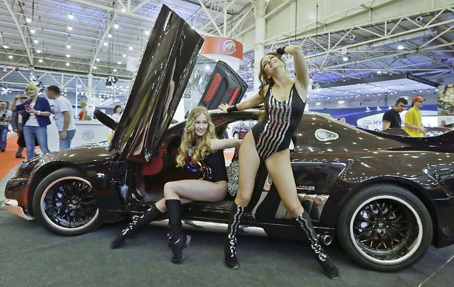 Please, ladies, we're trying to look at the car:This sleek gull-wing vehicle at 