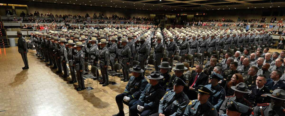 The 199th class of the New York State Police hand salute in the Convention Center of the Empire State Plaza May 29, 2013, during their graduation ceremony in Albany, N.Y. (Skip Dickstein/Times Union)