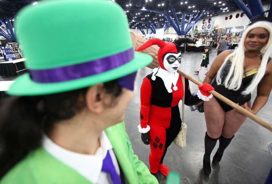 "Jasmynn Mann, 20, dressed as ""Harley Quinn,"" and Amber Mapp, dressed as Marvel's ""Storm""."