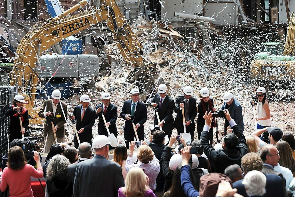 Confetti flies as local officials and museum dignitaries make the ceremonial first shovel dig at SFMOMA's groundbreaking ceremony for the museum's new 225,000-square-foot expansion in San Francisco, CA on Wednesday May 29th, 2013.