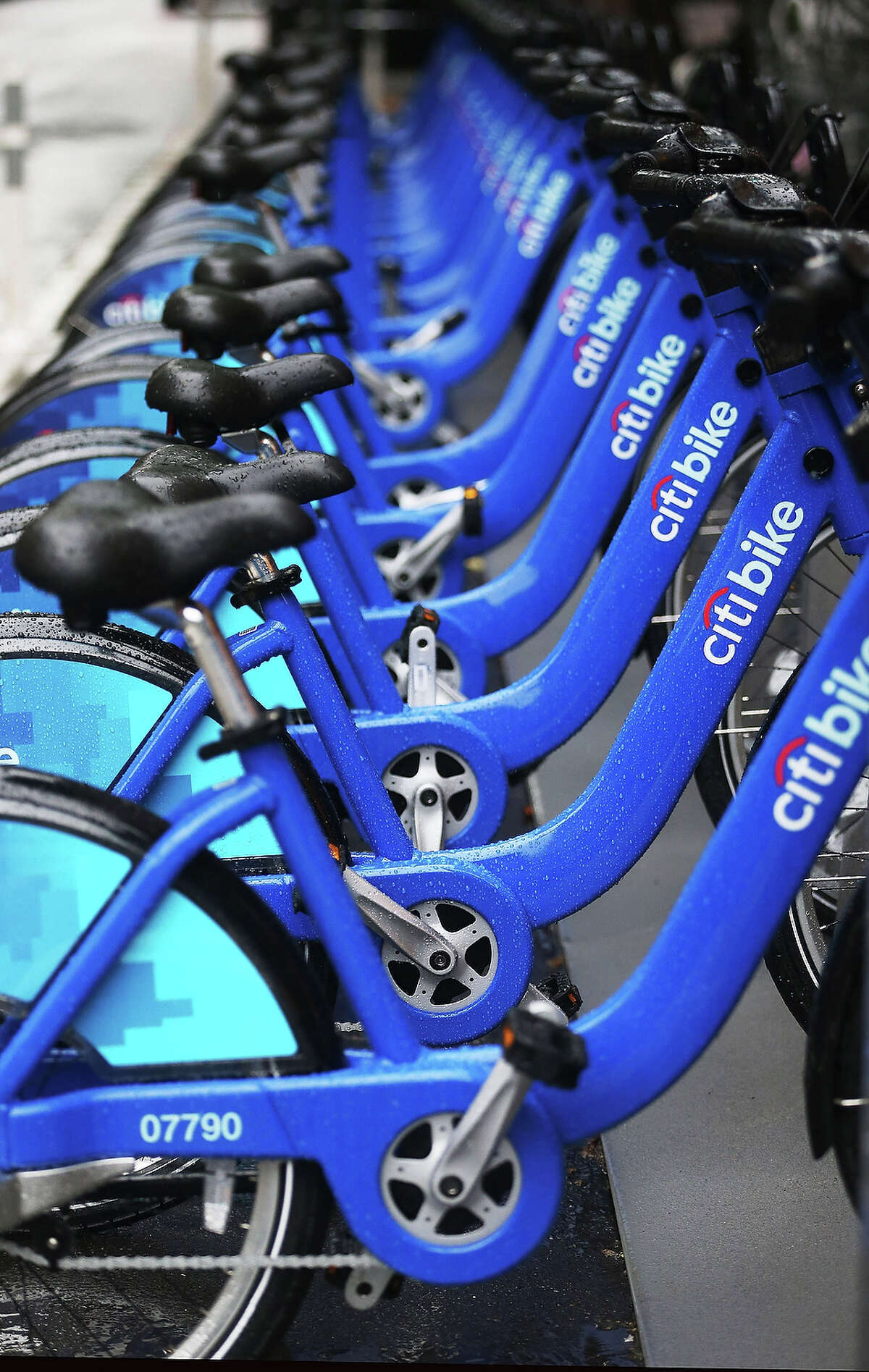 Citi Bikes sit on a rack in Manhattan's East Village the day after the nation's largest bike share program got underway on May 28, 2013 in New York City. The system provides 6,000 bicycles available for riders at docking stations located in certain parts of the city. About 15,000 people have already signed up for the controversial system, which is sponsored by Citibank and is the largest bike share program in the country.