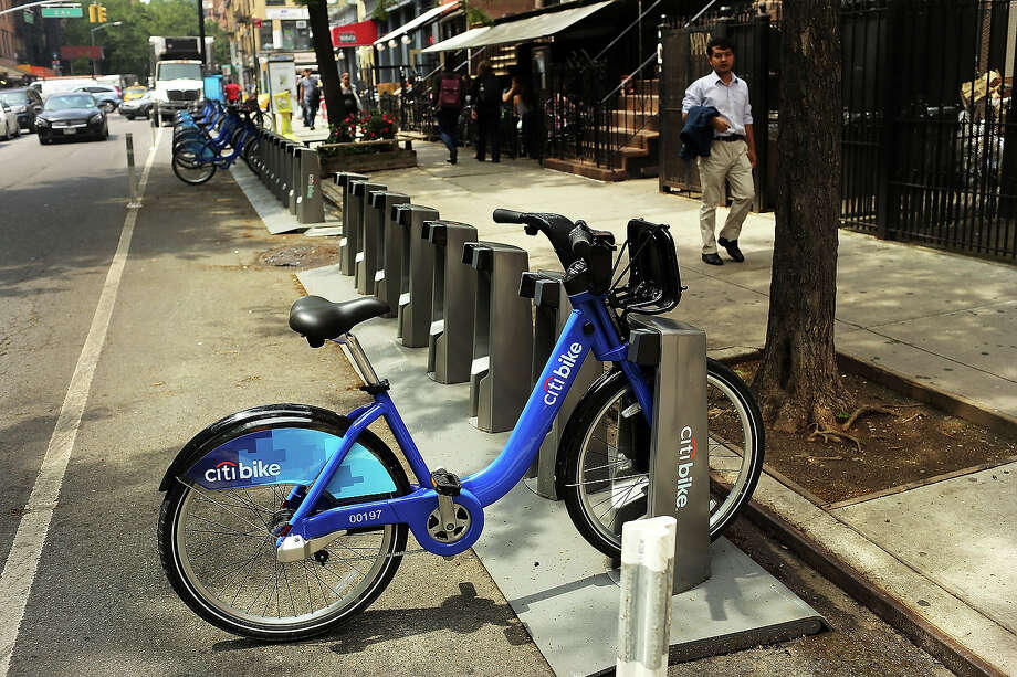 A Citi Bike stands in the East Village next to empty to a docking stations on May 29, 2013 in New York City. Citi Bike, the long awaited bike sharing program that launched over the Memorial Day weekend in New York, provides 6,000 bikes which are available for short-term rental at 330 stations in Manhattan below 59th Street and parts of Brooklyn. Until June 2nd only members of the Citi Bike program can use the bikes. The bikes will rent daily for $9.95 (plus tax ) or weekly for $25 and will be limited to trips of 30 minutes each. More than 16,000 people have signed up to be members so far. Photo: Spencer Platt, Getty Images / 2013 Getty Images