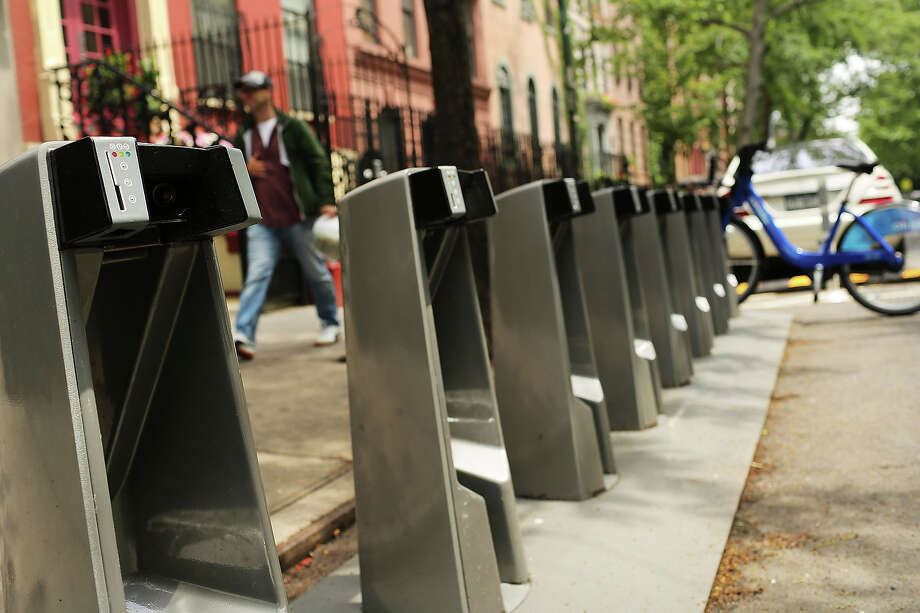 Empty Citi Bike docking stations stand in the East Village on May 29, 2013 in New York City. Citi Bike, the long awaited bike sharing program that launched over the Memorial Day weekend in New York, provides 6,000 bikes which are available for short-term rental at 330 stations in Manhattan below 59th Street and parts of Brooklyn. Until June 2nd only members of the Citi Bike program can use the bikes. The bikes will rent daily for $9.95 (plus tax ) or weekly for $25 and will be limited to trips of 30 minutes each. More than 16,000 people have signed up to be members so far. Photo: Spencer Platt, Getty Images / 2013 Getty Images