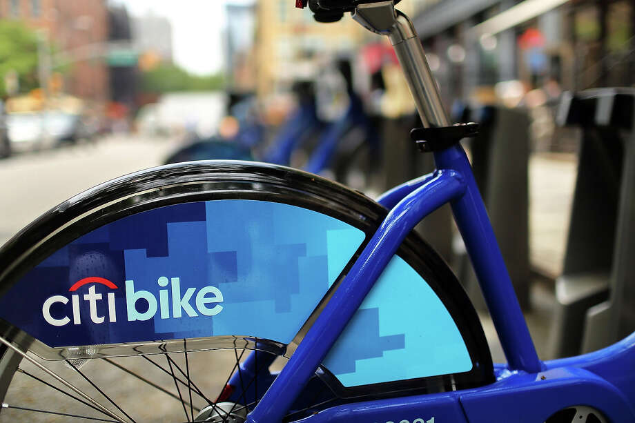 A Citi Bike stands at a docking station on May 29, 2013 in New York City. Citi Bike, the long awaited bike sharing program that launched over the Memorial Day weekend in New York, provides 6,000 bikes which are available for short-term rental at 330 stations in Manhattan below 59th Street and parts of Brooklyn. Until June 2nd only members of the Citi Bike program can use the bikes. The bikes will rent daily for $9.95 (plus tax ) or weekly for $25 and will be limited to trips of 30 minutes each. More than 16,000 people have signed up to be members so far. Photo: Spencer Platt, Getty Images / 2013 Getty Images