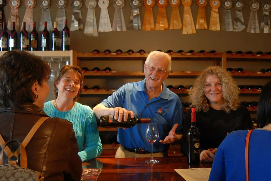 Tasting room staffers pour samples at Ramazzotti Wines in Geyserville. Photo: Ramazzotti
