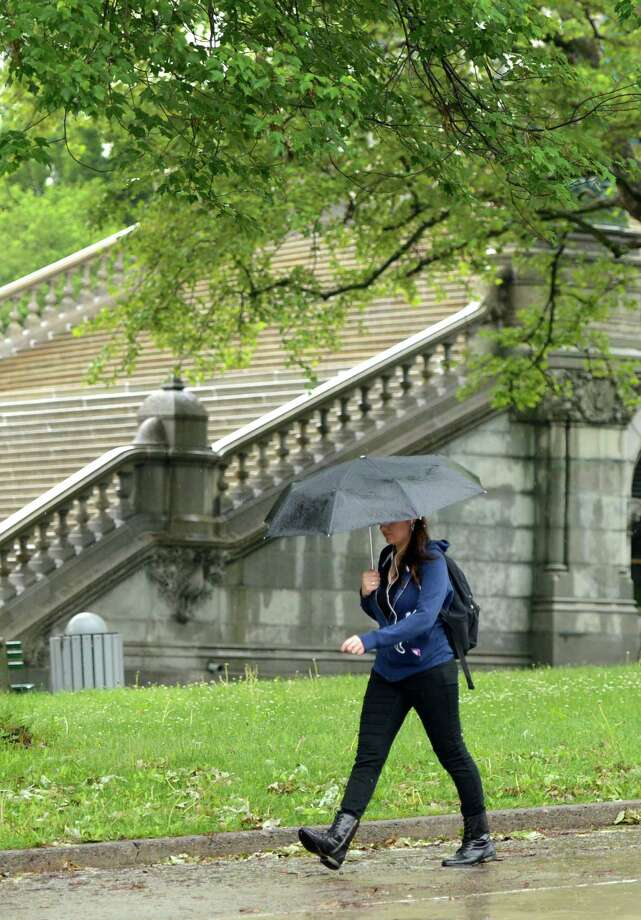 A pedestrian dodges the rain on May 29, 2013, in Albany, N.Y.  (Skip Dickstein/Times Union) Photo: SKIP DICKSTEIN / 00022611A