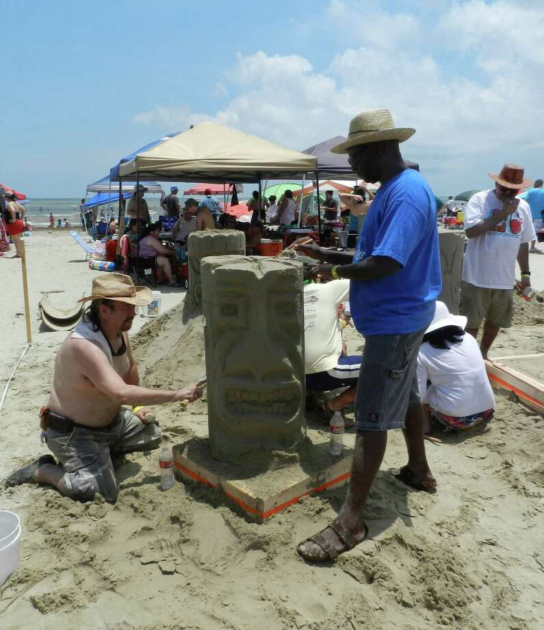 Luis Montes de Oca, left, and Joel Njenga, right of Wallace Garcia Wilson Architects in Houston work on their firm's 2012 entry in the AIA Sandcastle competition in Galveston. Photo: Courtesy Photo