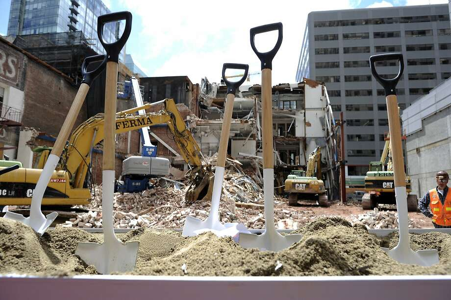 Shovels used for the ceremonial first dig sit in the ground in front of the construction area at SFMOMA's groundbreaking ceremony for the museum's new 225,000-square-foot expansion in San Francisco, CA on Wednesday May 29th, 2013. Photo: Michael Short, Special To The Chronicle