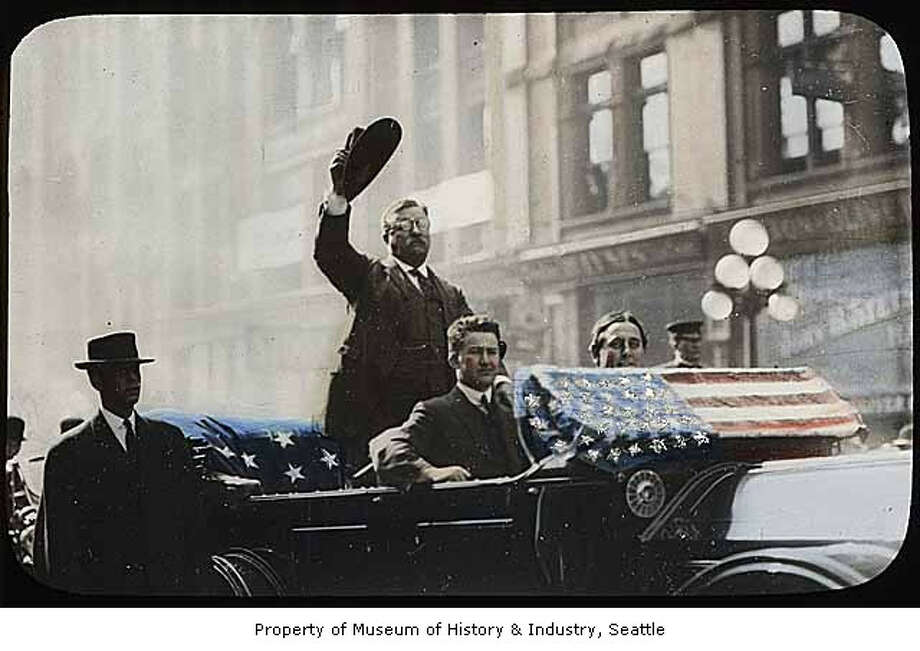 It was 110 years ago this month that President Theodore Roosevelt visited Seattle, as part of his weeks-long tour of the American West. Here's a look at his historic 1903 Seattle visit, beginning with Roosevelt waving from his motorcade in Pioneer Square.     (Photo: photographer unknown/copyright MOHAI, 2002.3.250). Photo: -