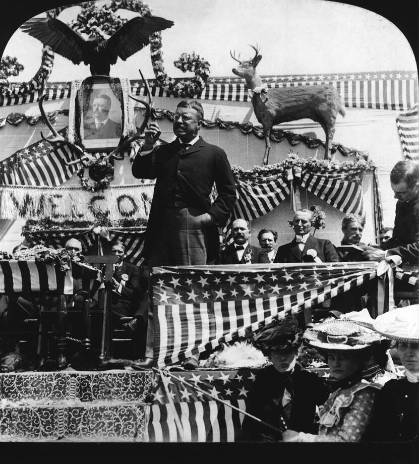 A popular president, Teddy Roosevelt is greeted with typical decorations at one of his stops during his 1903 tour of the American west. (Photo: Getty Images).  Photo: -