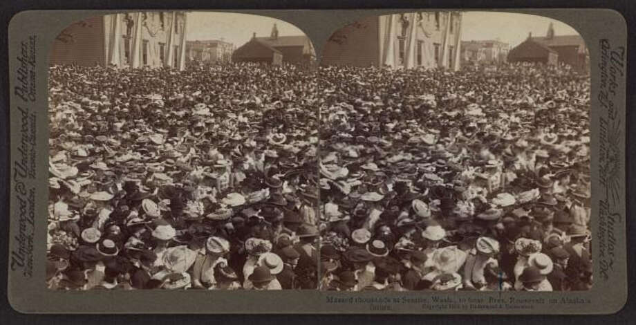 "According to HistoryLink, Seattle welcomed Roosevelt with a reception at the ""Grand Opera House"" on Cherry Street.  Photo, of the 1903 crowd in Seattle, is from the Library of Congress. Photo: -"
