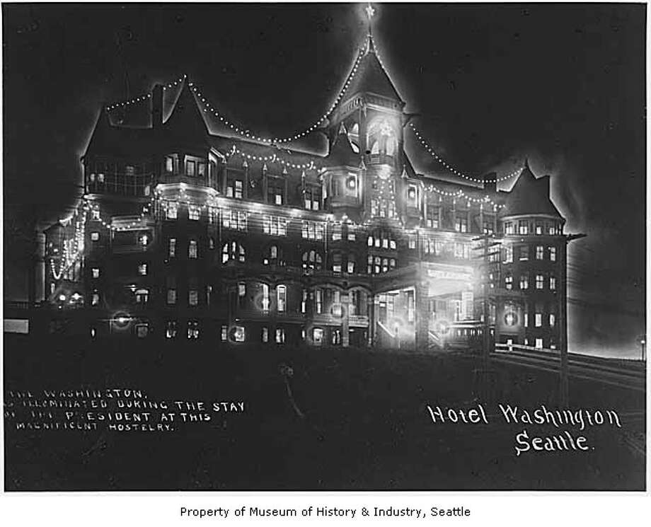 The Washington Hotel lasted only until 1906, when the western part of Denny Hill was leveled. It's pictured for Theodore Roosevelt's arrival in Seattle in 1903. (Photo: photographer unknown, copyright MOHAI, SHS7921). Photo: -