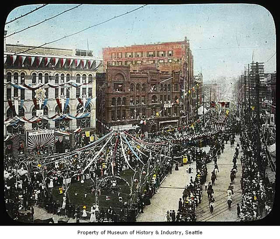 Thousands of people thronged a decorated Pioneer Square, pictured, to welcome Roosevelt during his two-day visit to Seattle and Everett. (Photo: Asahel Curtis/Copyright MOHAI, 2002.3.249). Photo: -