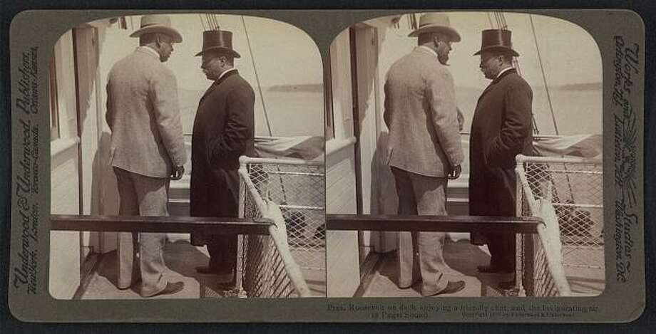 """Roosevelt arrived by the steamship Spokane, which docked in Seattle on May 23, 1903. The caption on this 1903 photo reads: """"Pres. Roosevelt on deck enjoying a friendly chat and the invigorating air of Puget Sound."""" (Photo: Library of Congress).  Photo: -"""