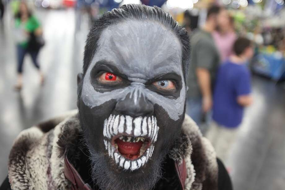 Anthony Huynh, 28, dressed in an original costume, tries to scare people.
