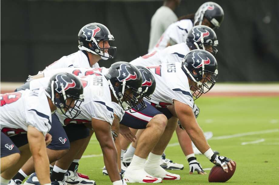 Texans quarterback Matt Schaub lines up under center during Wednesday's organized team activities at the Methodist Training Center.