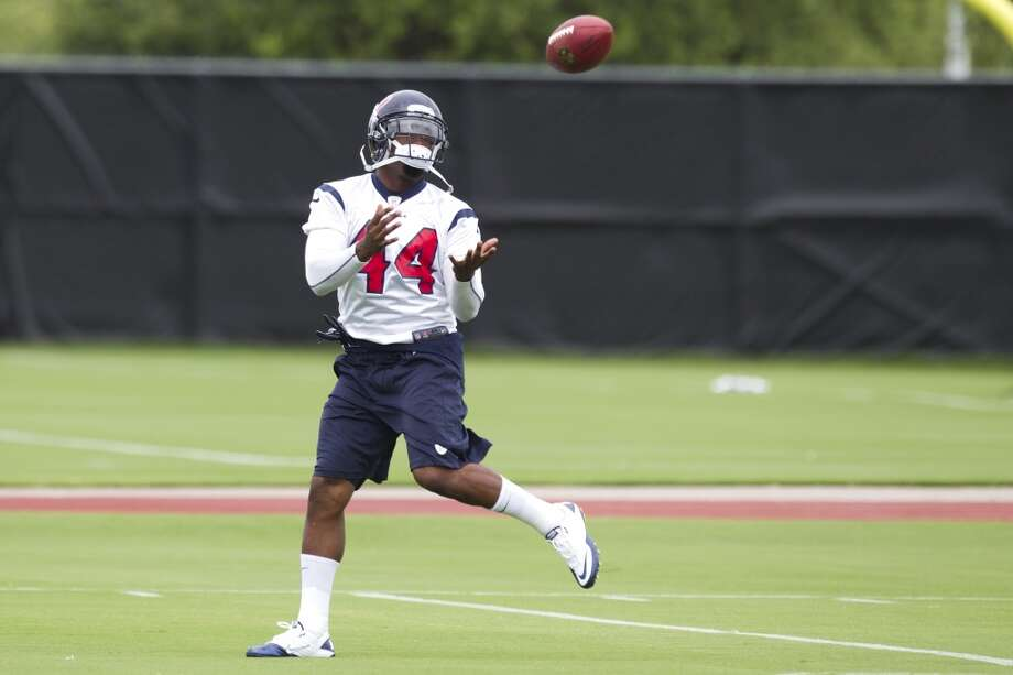 Running back Ben Tate reaches out to catch a pass.