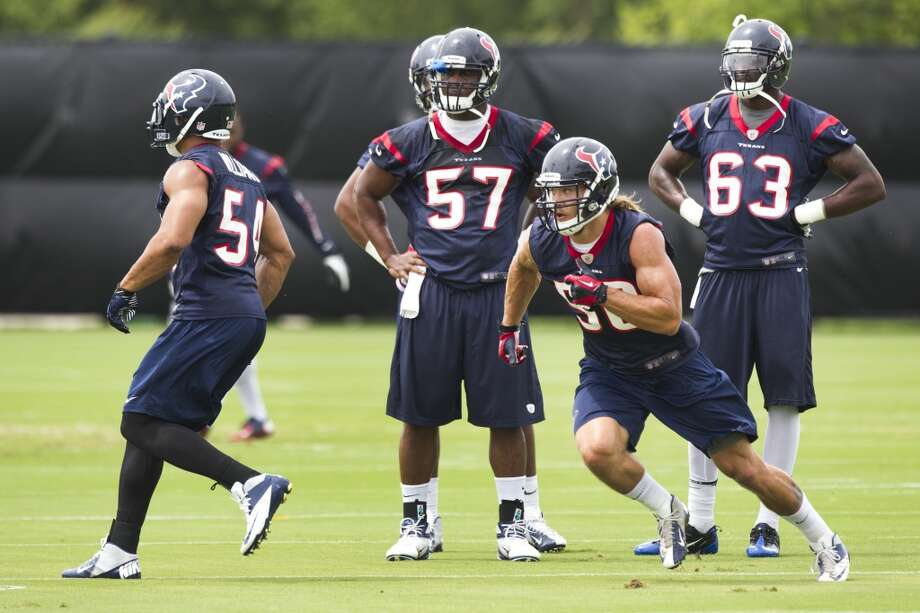 Texans linebackers Trevardo Williams (54), Sam Montgomery (57) Brian Braman (50) and Willie Jefferson (63) run drills.