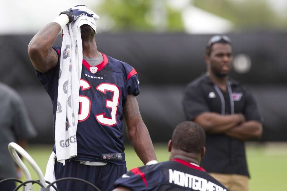 Texans linebacker Willie Jefferson (63) wipes his face with a towel during a break in practice.