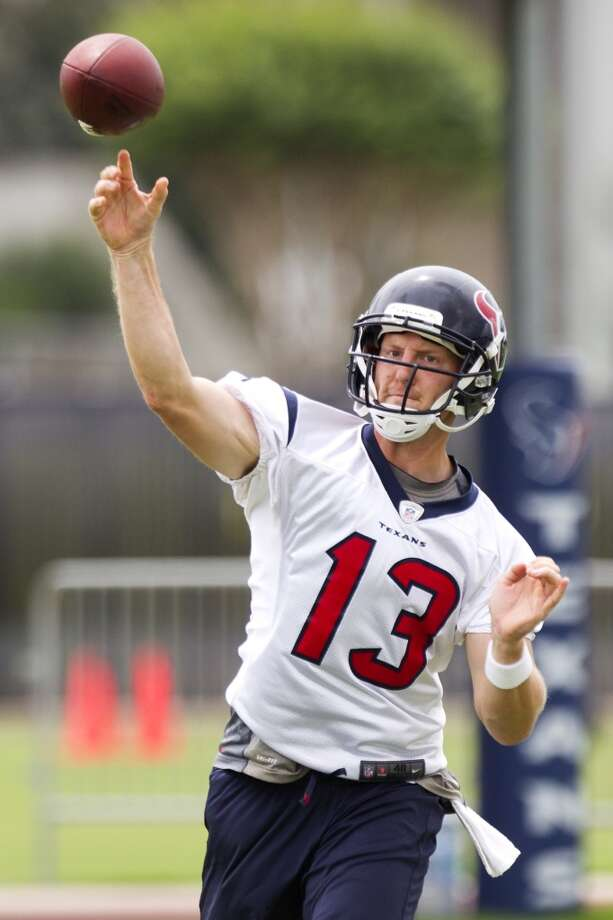Texans quarterback T.J. Yates throws a pass.