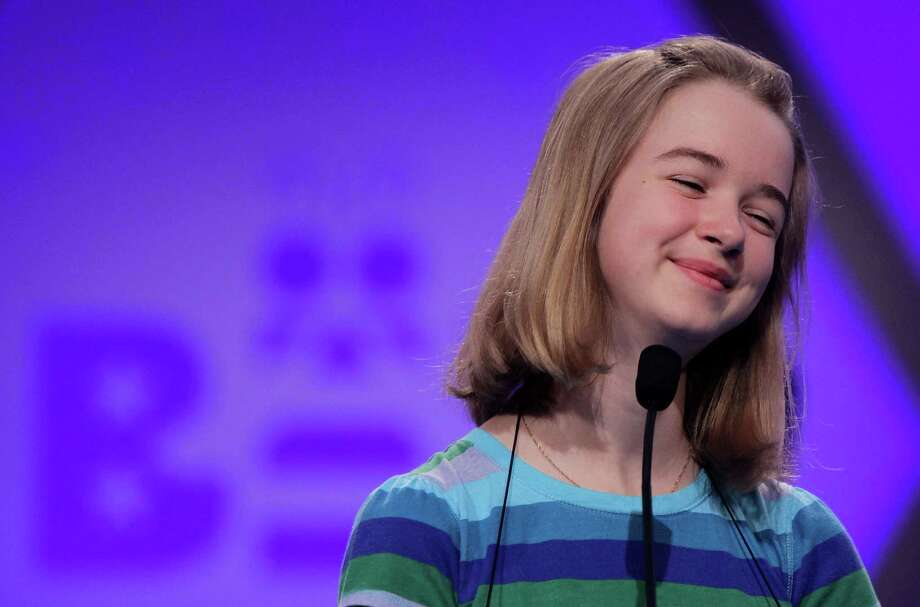 """NATIONAL HARBOR, MD - MAY 29:  Mollie J. Symons of Halifax, Nova Scotia, Canada, smiles as she participates in the round two of the 2013 Scripps National Spelling Bee May 29, 2013 at Gaylord National Resort and Convention Center in National Harbor, Maryland. Two hundred and eighty spellers competed in the annual spelling contest for the championship. Symons correctly spelled the word """"charpoy"""" in the round. (Photo by Alex Wong/Getty Images) Photo: Alex Wong, Getty Images / 2013 Getty Images"""