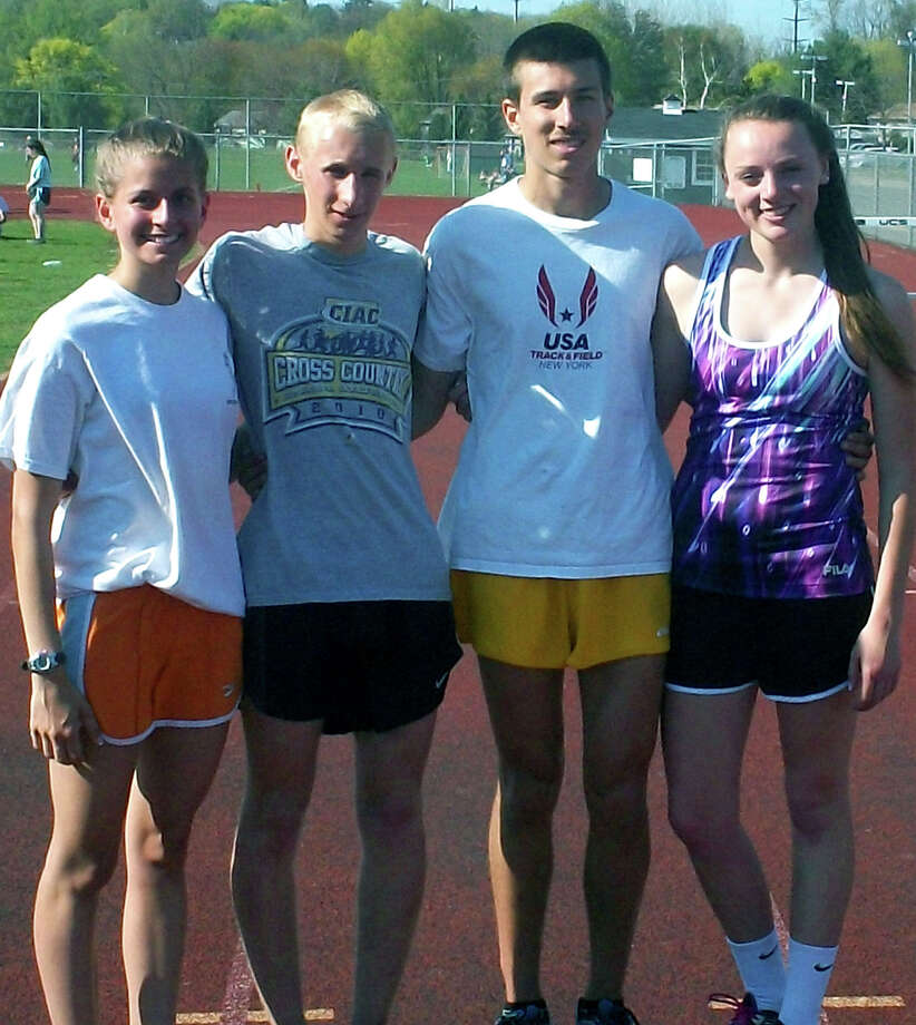 Representing the New Milford High School track & field and cross country programs in accepting grant money from the Roxbury road race series are Green Wave athletes, from left to right, Sofia Amaral, John Hansell, Ryan Clarke and Jessica Noteware. May 2013  Courtesy of Scott Benjamin Photo: Contributed Photo